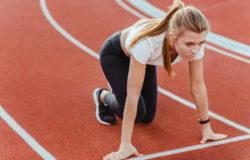 Female runner standing in start position