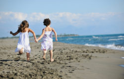 cute little girls running on beach